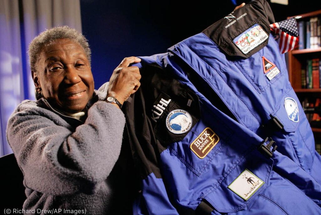 Barbara Hillary holding up jacket (© Richard Drew/AP Images)
