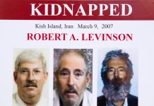 Poster with three photographs of Robert Levinson (© Manuel Balce Ceneta/AP Images)
