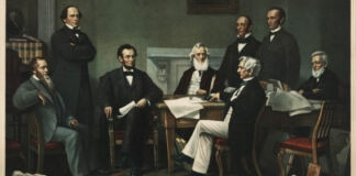 Painting of seated and standing men looking at papers (© Shutterstock)