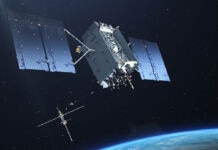 Satellite hovering over Earth (© Lockheed Martin)