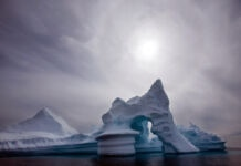 Iceberg in water (© John McConnico/AP Images)