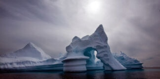 Iceberg in the water (© John McConnico/AP Images)