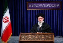 Ayatollah Ali Khamenei speaking behind lectern (© Office of the Iranian Supreme Leader/AP Images)