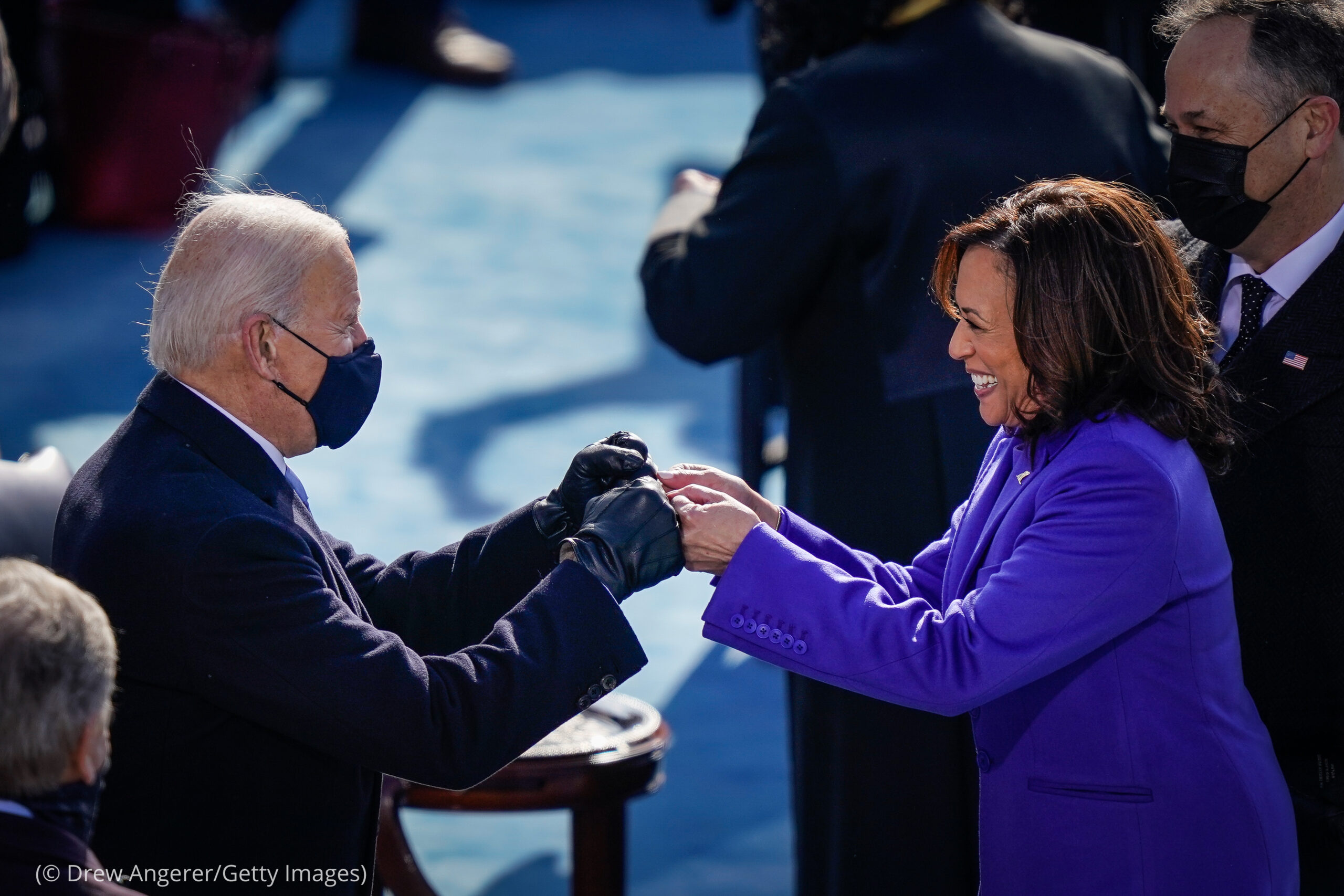 Joe Biden fist bumping with Kamala Harris at inauguration (© Drew Angerer/Getty Images)