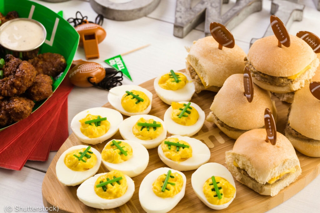 Deviled eggs and sliders decorated as American footballs (© Shutterstock)