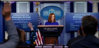 White House press secretary Jen Psaki at lectern (© AP Images/Evan Vucci)