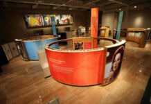 Circular panels display photographs and text at museum (Courtesy of the National Museum of American Diplomacy)