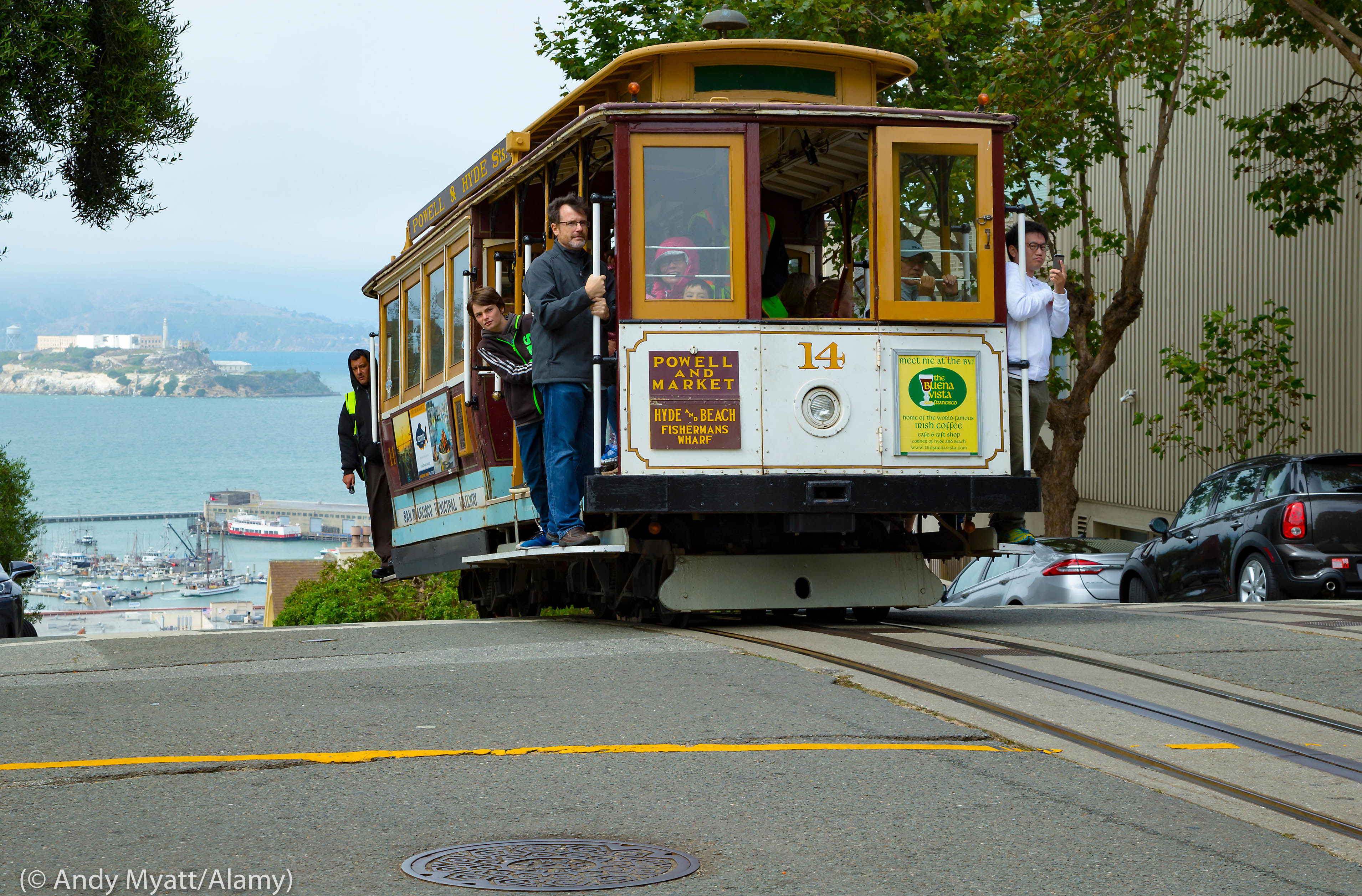 People riding a cable car (© Andy Myatt/Alamy)