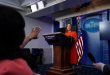 White House press secretary Jen Psaki speaking with reporters (© Alex Brandon/AP Images)