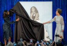 Michelle Obama and Amy Sherald unveiling portrait of Michelle Obama (© Andrew Harnik/AP Images)