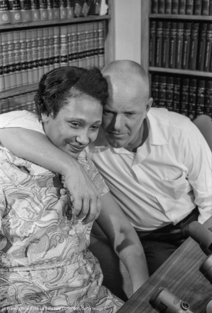 Richard Loving with arm around Mildred Loving in book-lined office (© Francis Miller/The LIFE Picture Collection/Getty Images)