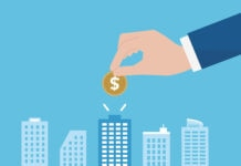 Illustration of skyline with hand dropping coin into one building (© Shutterstock)