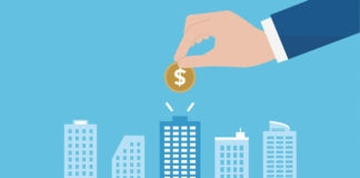 Illustration of hand dropping coin into a building of a skyling (© Shutterstock)