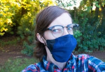 Woman wearing glasses and blue mask (© ASU Luminosity Lab)