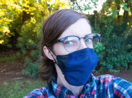 Woman wearing glasses and a blue mask (© John Patterson/ASU Luminosity Lab)