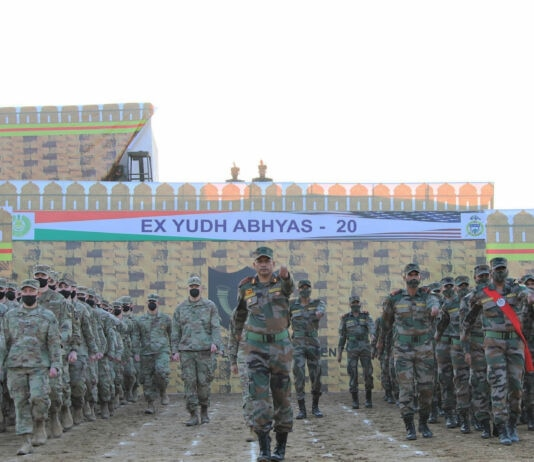 Indian and American military men standing in formation (