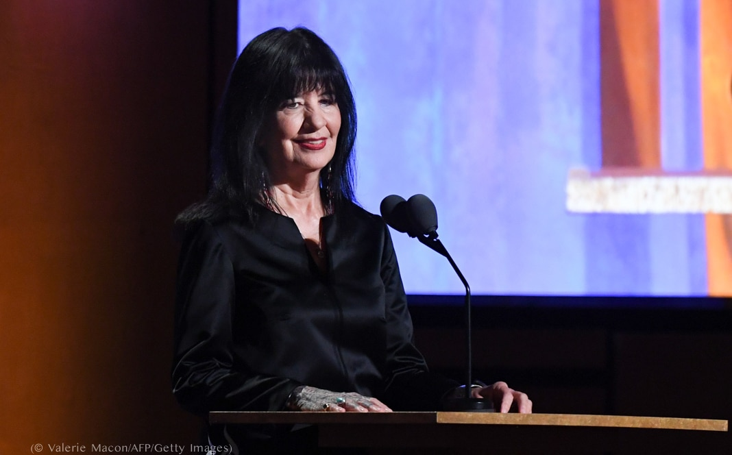 Joy Harjo standing behind lectern (© Valerie Macon/AFP/Getty Images)