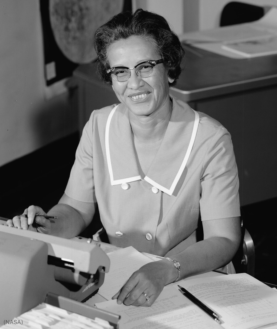 Katherine Johnson posing for a photograph at her office desk (NASA)
