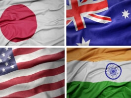 Collage of flags of Japan, Australia, United States and India (State Dept./Flag images: © Shutterstock)