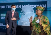 World Trade Organization (WTO) Director-General Ngozi Okonjo-Iweala speaking next to an ice sculpture depicting fish (© Fabrice Coffrini/AFP/Getty Images)