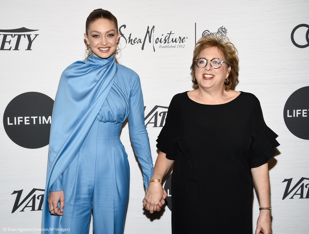 Gigi Hadid holding hands with Caryl Stern (© Evan Agostini/Invision/AP Images)