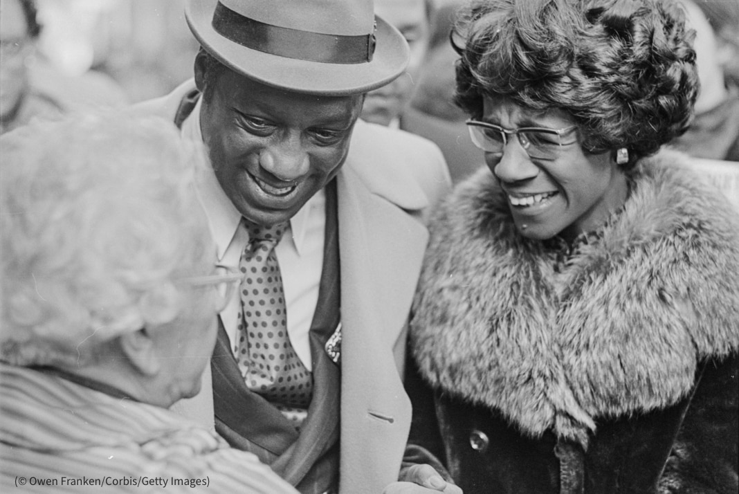 Shirley Chisholm and man talking with woman (© Owen Franken/Corbis/Getty Images)