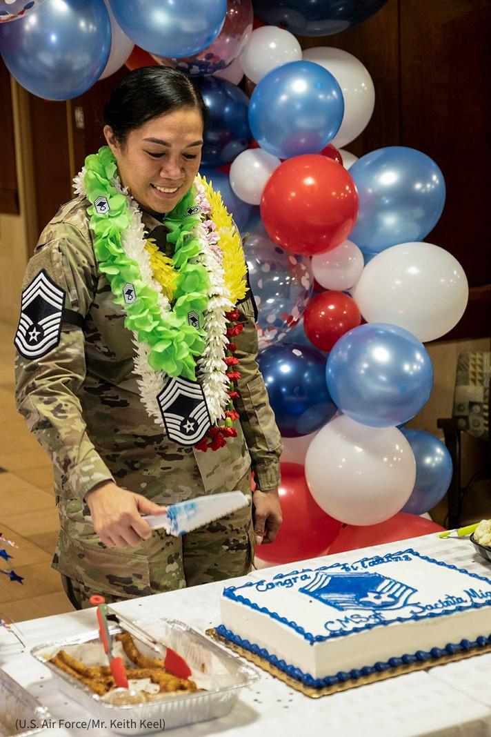 U.S. Airforce woman cutting a cake (U.S. Air Force/Mr. Keith Keel)