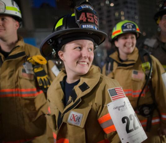 Firefighters in full gear smiling (© John Minchillo/AP Images)