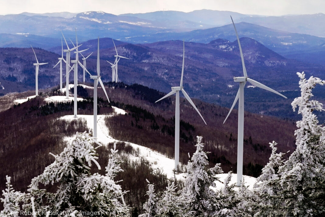Wind turbines on top of mountain (© Robert F. Bukaty/AP Images)