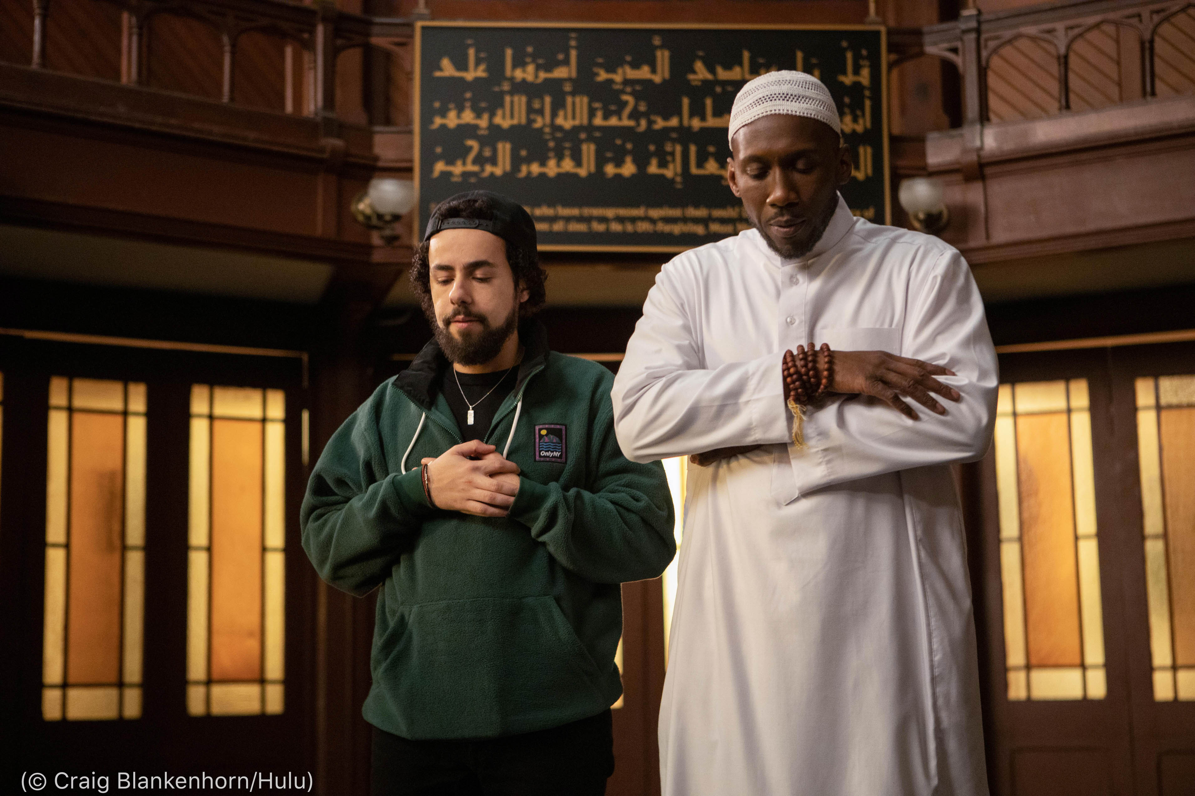 Two actors portraying Muslim men praying (© Craig Blankenhorn/Hulu)
