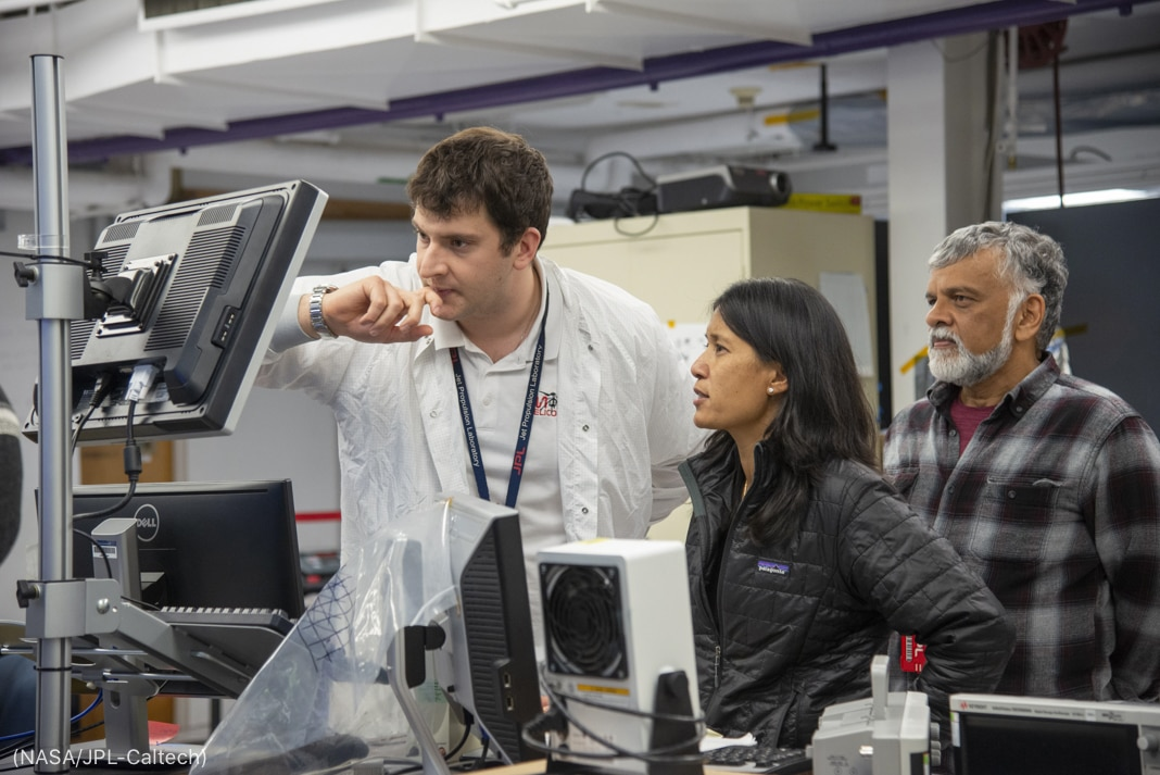 MiMi Aung and two men looking at screen in lab (NASA/JPL-Caltech)