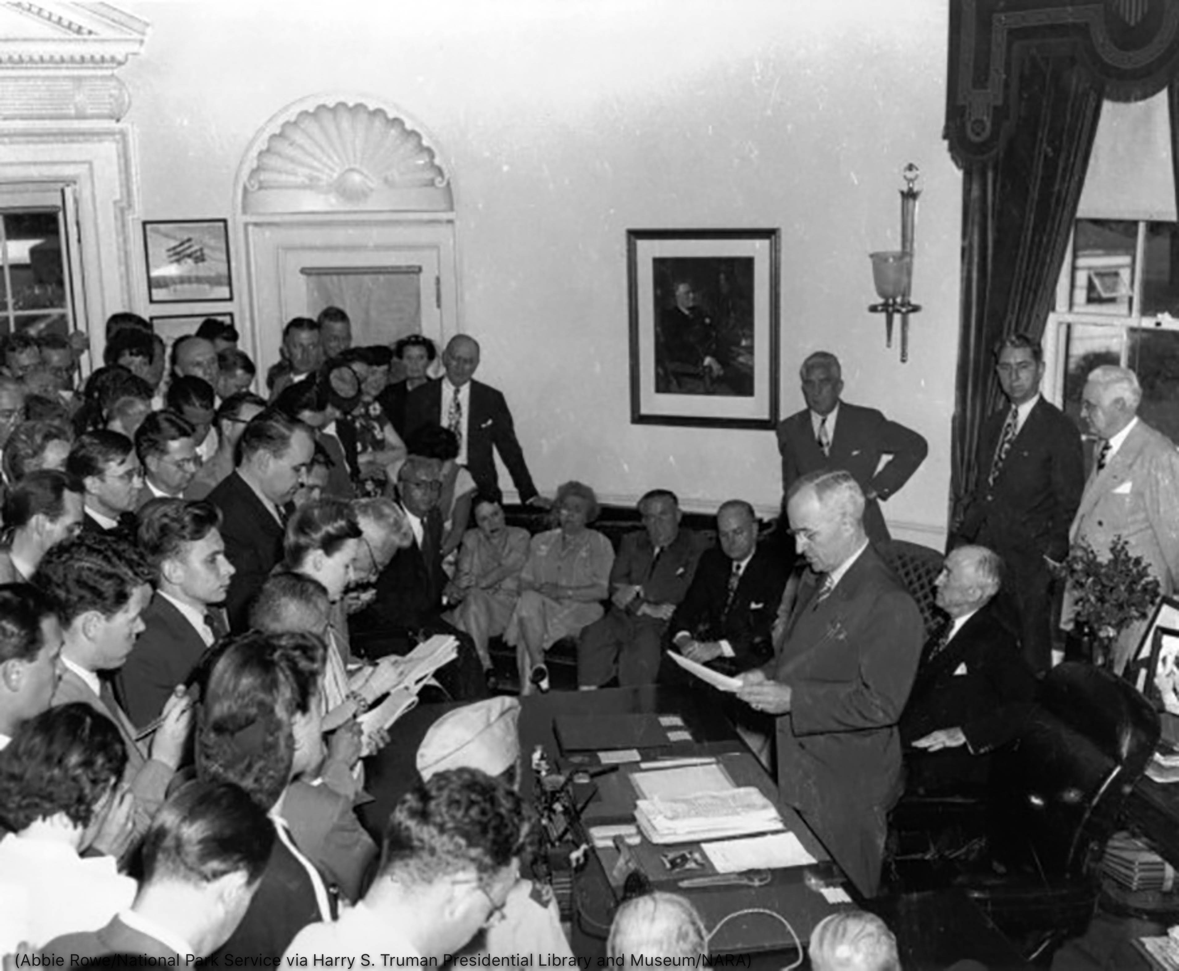 President Truman speaking to reporters while they take notes (Abbie Rowe/National Park Service via Harry S. Truman Presidential Library and Museum/NARA)