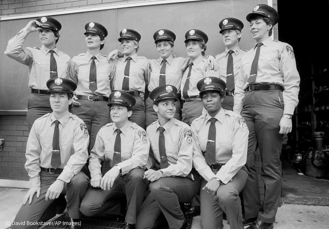 Group of female firefighters posing for photo in two rows (© David Bookstaver/AP Images)