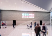 Artist's rendering of people walking in hall with engraved words on one wall arranged around a stylized American flag (© Elia Architecture & Interiors)