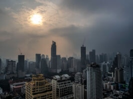 Sun seen through haze above city (© Gemunu Amarasinghe/AP Images)