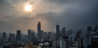 Sun seen through haze above city (© Gemunu Amarasinghe/AP Images)