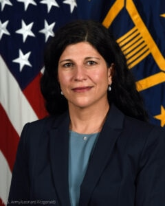 Portrait of woman in front of two flags (U.S. Army/Leonard FItzgerald)