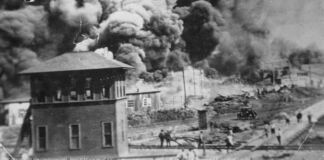 Historical photo of buildings burning (Collection of the Smithsonian National Museum of African American History and Culture, Gift of Cassandra P. Johnson Smith)