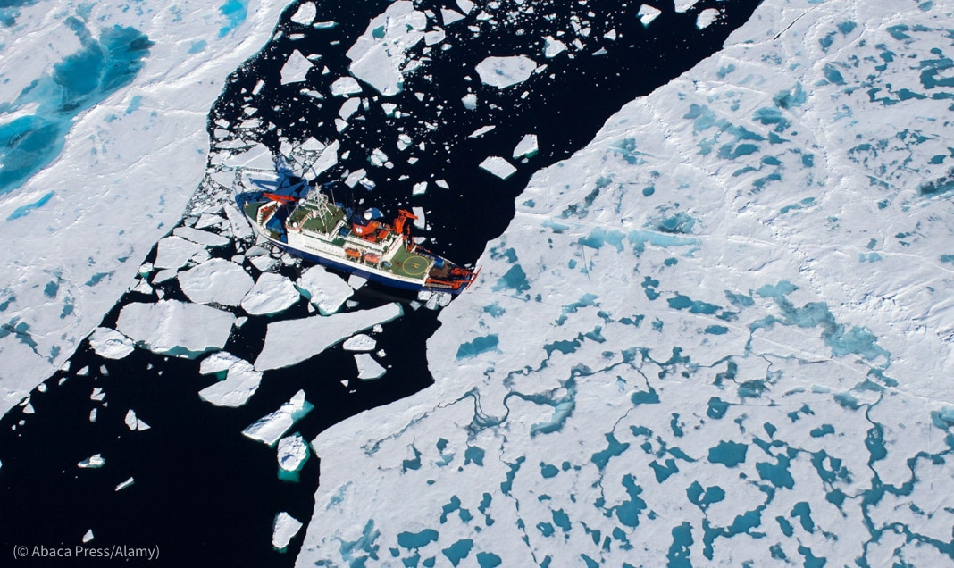 Boat on open water between ice floes (© Abaca Press/Alamy)