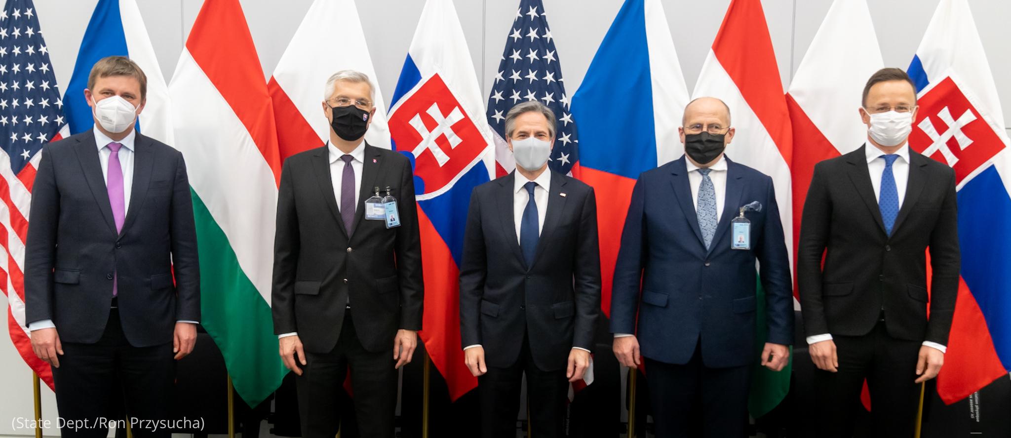 Antony J. Blinken standing with group of men in suits (State Dept./Ron Przysucha)