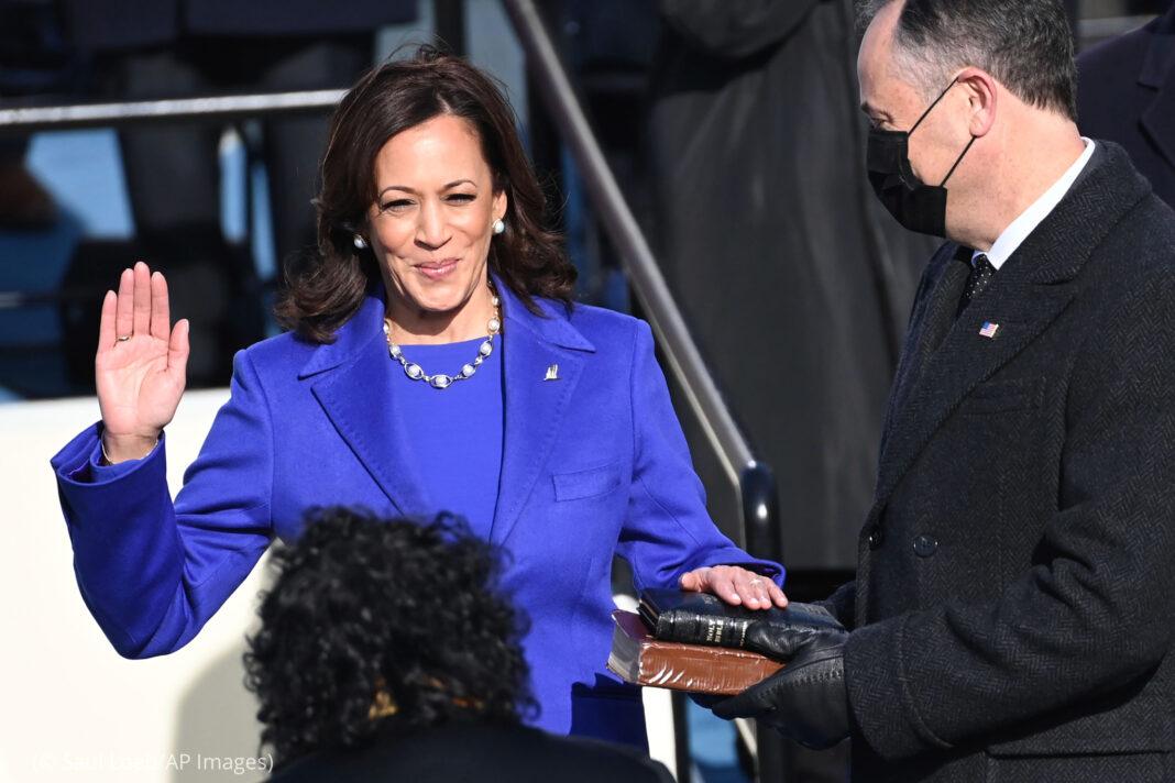 Kamala Harris taking the oath of office (© Saul Loeb/AP Images)