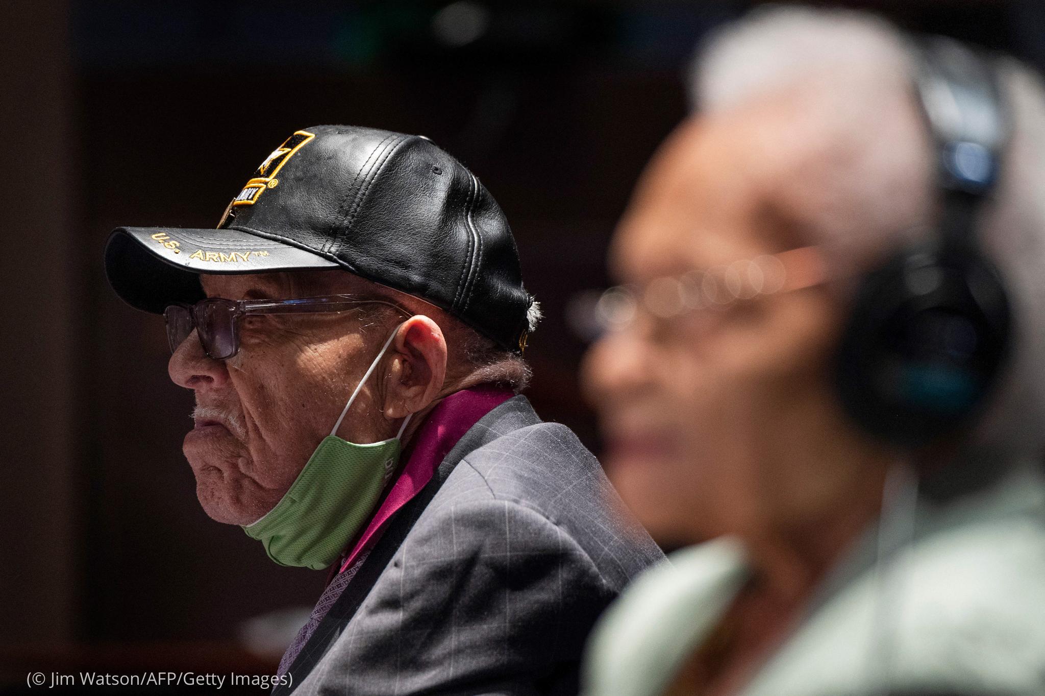 Фотография мужчины и женщины в профиль (© Jim Watson/AFP/Getty Images)