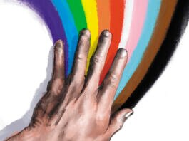 Hand spreading rainbow (State Dept./D. Thompson)