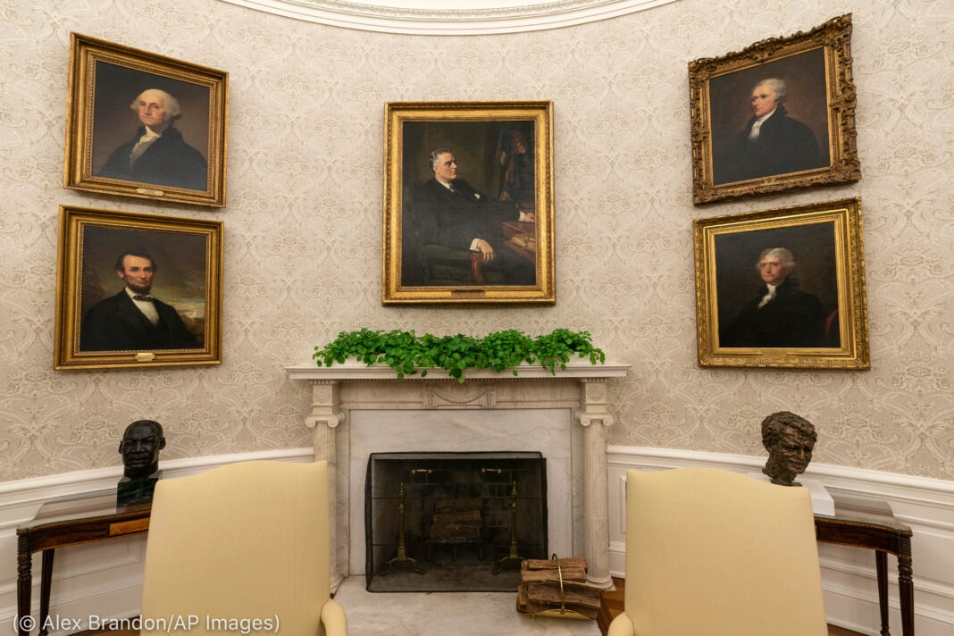 Framed pictures hanging on one wall of the Oval Office (© Alex Brandon/AP Images)