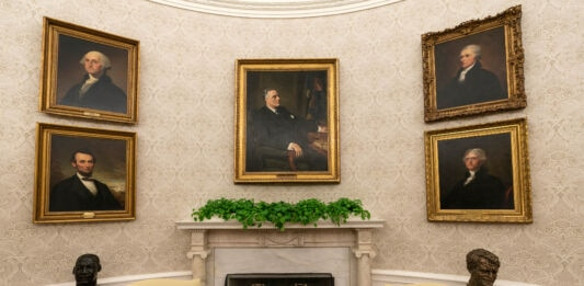 Framed pictures hanging on wall of Oval Office (© Alex Brandon/AP Images)
