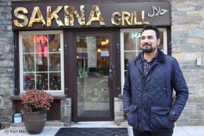 Kazi Mannan standing outside his restaurant (© Kazi Mannan)