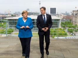 Secretary of State Antony J. Blinken walking with German Chancellor Angela Merkel (State Dept./Ron Przysucha)