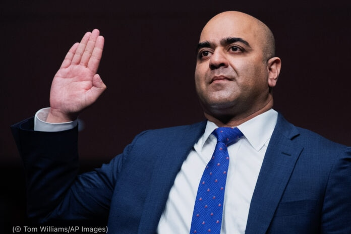 Man holding hand for swearing in