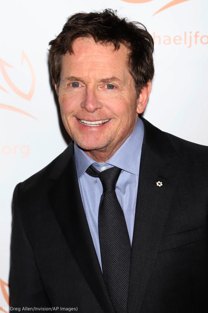 Michael J. Fox sonríe (© Greg Allen/Invision/AP Images)