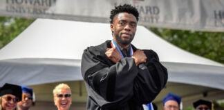 Chadwick Boseman crossing arms over his chest (